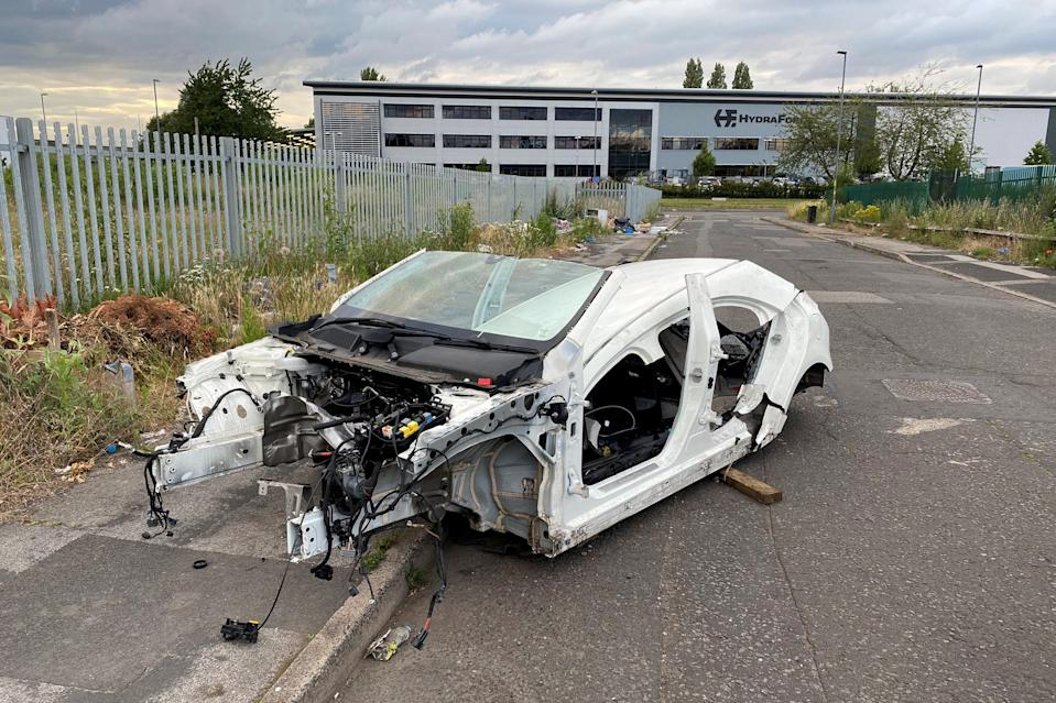 Police are hunting 'car cannibals' after Mercedes Benz was found stripped bare by thieves.  See SWNS story SWMDcar.  The car which was stolen in February was found by police in Birmingham completely stripped, with just the chopped up body frame and windscreen left stradling the road and pavement on an industrial estate. (SWNS)