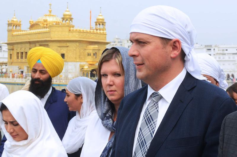 <p>Federal Conservative Leader Andrew Scheer and his wife, Jill Scheer, pay their respects at the Sikh shrine of Golden Temple in Amritsar, India, on Oct. 10, 2018. Photo from Getty Images. </p>