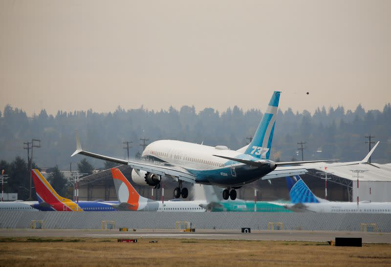 FILE PHOTO: A Boeing 737 MAX aircraft lands during an evaluation flight in Seattle