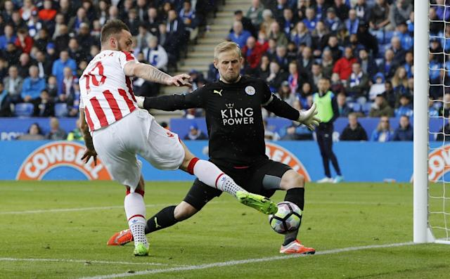 <p>Leicester City's Kasper Schmeichel saves from Stoke City's Marko Arnautovic </p>
