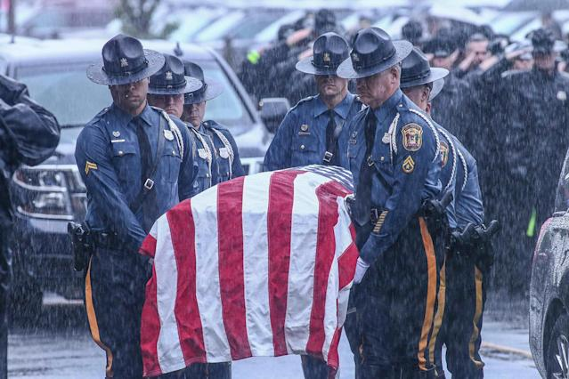 <p>Fellow troopers carry the casket of Corporal Stephen J. Ballard during his funeral services held at the Chase Center On The Riverfront in Wilmington Delaware, May 5, 2017. Ballard was gunned down on April 26, 2017 in a Bear-area (Photo: Saquan Stimpson via ZUMA Wire) </p>