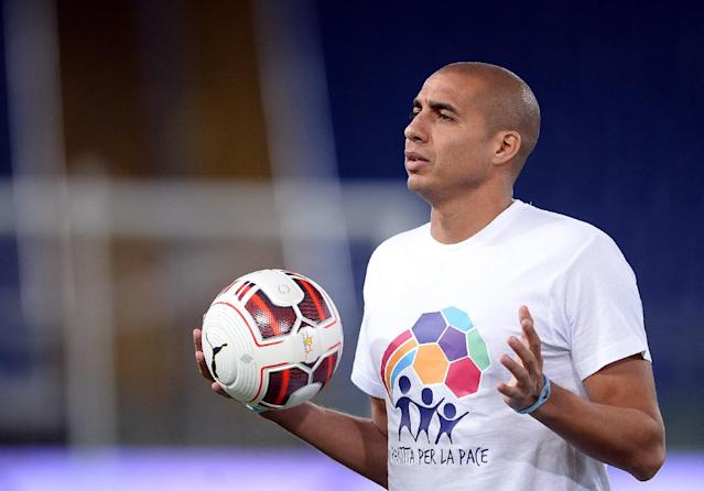 "French foward David Trezeguet stands during the inter religious ""match for peace"" football game in Rome's Olympic Stadium on September 1, 2014 (AFP Photo/Filippo Monteforte)"
