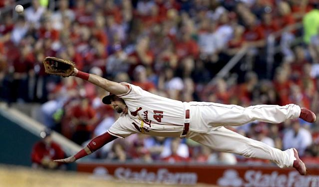 St. Louis Cardinals first baseman Brock Peterson dives but cannot reach a ball hit for a single by Seattle Mariners' Kendrys Morales during the fourth inning of a baseball game, Saturday, Sept. 14, 2013, in St. Louis. (AP Photo/Jeff Roberson)