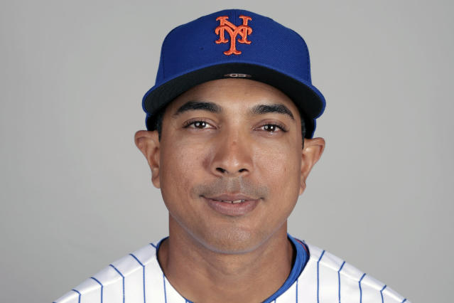 FILE - This is a 2019 photo showing Luis Rojas of the New York Mets baseball team. The New York Mets are finalizing a multiyear agreement with quality control coach Luis Rojas to make him the teams new manager, general manager Brodie Van Wagenen said Wednesday, Jan. 22, 2020. Rojas would replace Carlos Beltrn, who left the team last week before managing a single game as part of the fallout from the Houston Astros' sign-stealing scandal. (AP Photo/John Raoux, File)
