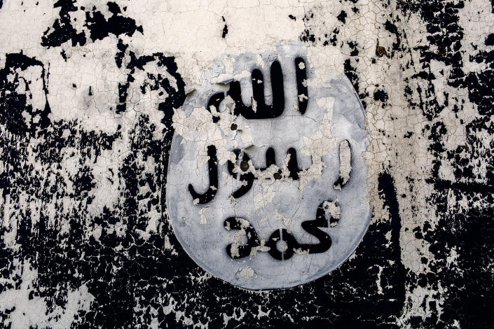 """<p>A wall is painted with the black flag commonly used by Islamic State group militants.The Khatam an-Nabiyyin, """"The Seal of Muhammad,"""" was adopted by jihadists for use on flags in 2006. Seen in Sinjar, Iraq, on April 7, 2016. (Photograph by Diego Ibarra Sanchez / MeMo) </p>"""