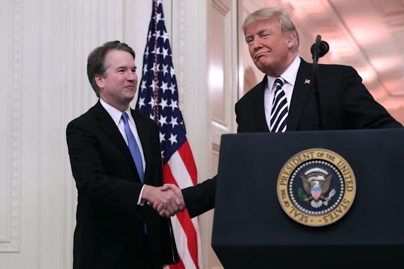 U.S. Supreme Court Justice Brett Kavanaugh (L) shakes hands with President Donald Trump during Kavanaugh's ceremonial swearing in in the East Room of the White House October 08, 2018 in Washington, DC. Kavanaugh was confirmed in the Senate 50-48 after a contentious process that included several women accusing Kavanaugh of sexual assault. Kavanaugh has denied the allegations. (Photo: Chip Somodevilla/Getty Images)