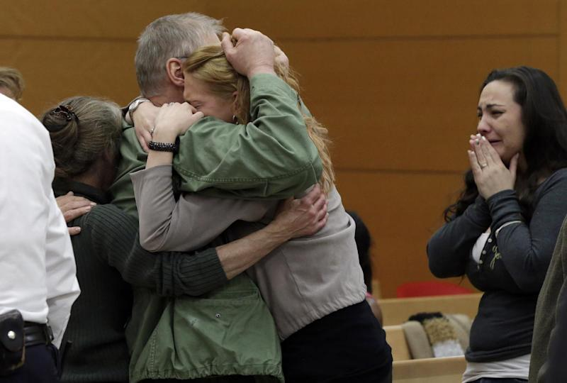 David Ranta is hugged by family members after Judge Miriam Cyrulnik freed him, in state Supreme Court in Brooklyn, New York, Thursday, March 21, 2013. Ranta, 58, who spent more than two decades behind bars was freed on Thursday after a reinvestigation of his case cast serious doubt on evidence used to convict him in the Feb. 8, 1990 shooting of Rabbi Chaskel Werzberger. (AP Photo/Richard Drew, Pool)