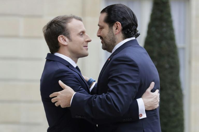 French President Emmanuel Macron welcomes Lebanese Prime Minister Saad Hariri at the Elysee Presidential Palace in Paris
