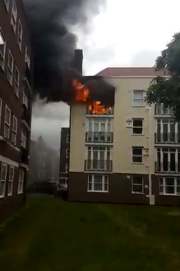 Fire: Smoke was seen billowing out of the windows of the building