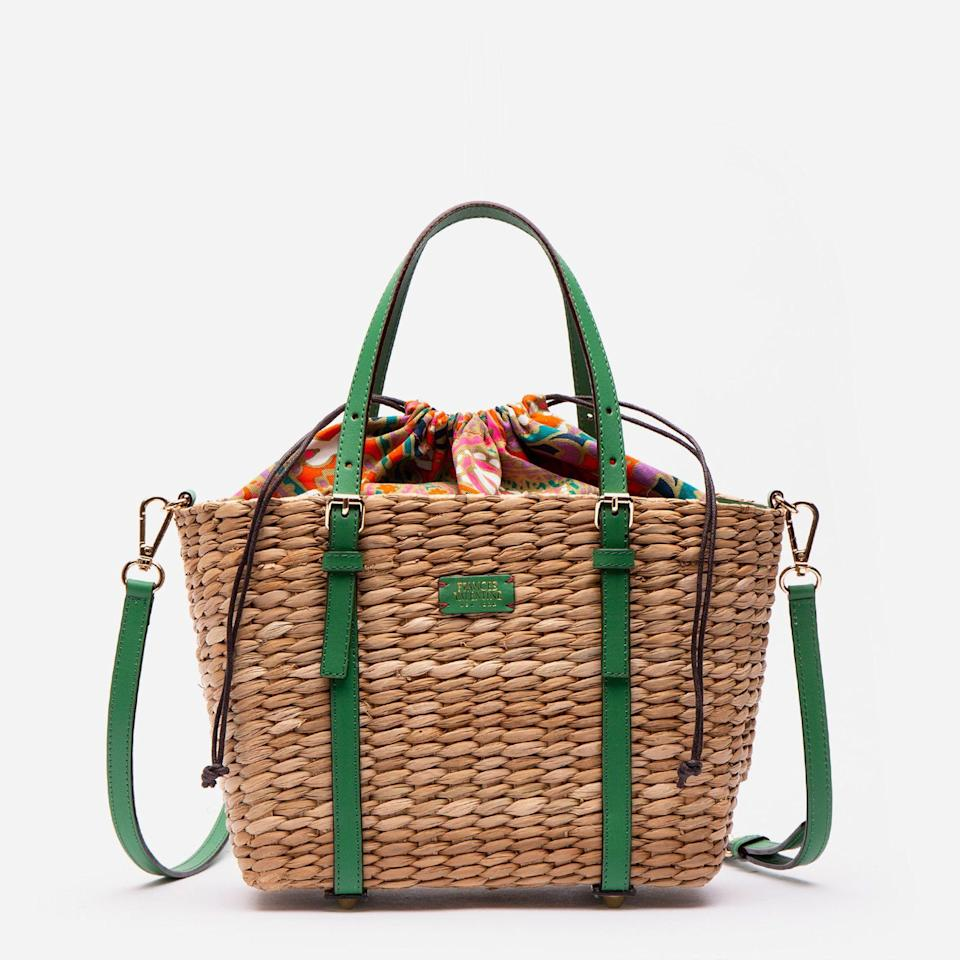 """<p><strong>Frances Valentine</strong></p><p>francesvalentine.com</p><p><strong>$198.00</strong></p><p><a href=""""https://francesvalentine.com/collections/handbags/products/small-woven-basket-tote-green-ray-vachetta"""" rel=""""nofollow noopener"""" target=""""_blank"""" data-ylk=""""slk:Shop Now"""" class=""""link rapid-noclick-resp"""">Shop Now</a></p><p>Bold green leather accents make this straw baby stand out. Wear it as a top handle or attach the shoulder strap and style it as a crossbody. It also has metal feet to protect the bottom no matter where you set it down. </p>"""