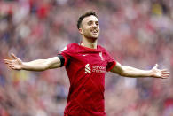 Liverpool's Diogo Jota celebrates scoring during the English Premier League soccer match between Liverpool and Burnley at Anfield, Liverpool, England, Saturday Aug. 21, 2021. (Mike Egerton/PA via AP)