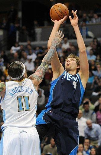 Dallas Mavericks forward Dirk Nowitzki (4), of Germany, shoots over Denver Nuggets forward Chris Anderson (11) in the first quarter of an NBA basketball game in Denver on Wednesday, Feb. 8, 2012. (AP Photo/Chris Schneider)