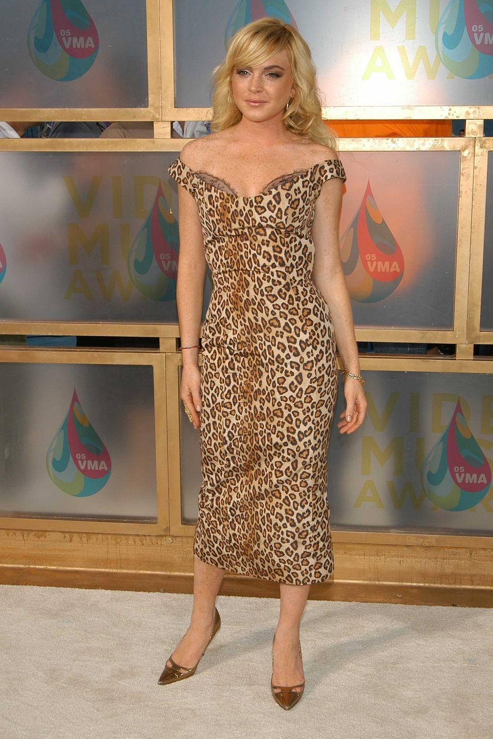 <p>Lindsay Lohan went all in on leopard print in this off-the-shoulder midi dress, which she wore in 2005.</p>