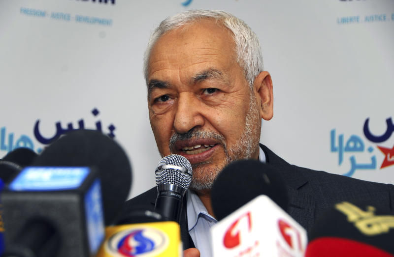 The leader of the Islamist Ennahda Party, Rached Ghannouchi, delivers a statement in Tunis, Monday, March 26, 2012. Islamic law will not be enshrined in Tunisia's new constitution, preserving the secular basis of the North African nation, Tunisia's ruling Islamist Ennahda Party said Monday.The decision marks a break between the moderate Islamist Ennahda and an increasingly vocal minority of ultraconservative Muslims known as Salafis who have been demanding Islamic law in a country long known for its progressive traditions. (AP Photo/Hassene Dridi)
