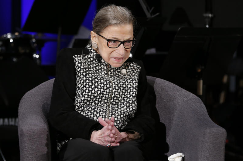 FILE - In this Dec. 17, 2019, file photo Supreme Court Justice Ruth Bader Ginsburg speaks with author Jeffrey Rosen at the National Constitution Center Americas Town Hall at the National Museum of Women in the Arts in Washington. (AP Photo/Steve Helber, File)