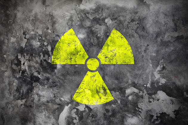 Radiation sign on grey wall (photo: Thinkstock)