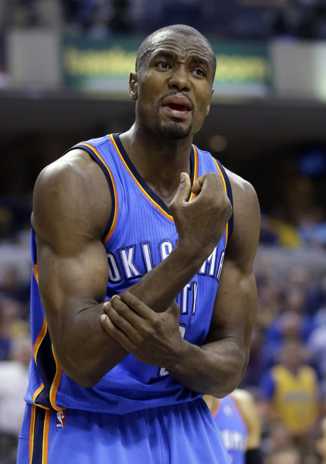 Oklahoma City Thunder forward Serge Ibaka complains about a call in the second half of an NBA basketball game against the Indiana Pacers in Indianapolis, Sunday, April 13, 2014. Ibaka was called for a technical for the exchange with an official. The Pacers defeated the Thunder 102-97. (AP Photo/Michael Conroy)