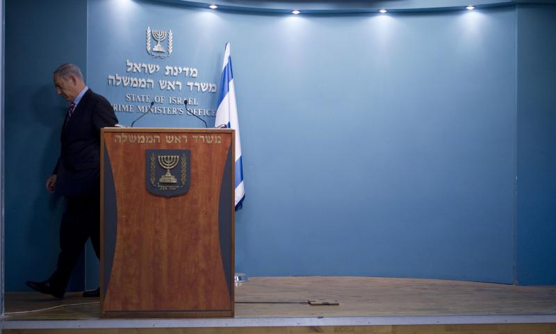 Israel's PM Netanyahu leaves after delivering a statement at his office in Jerusalem