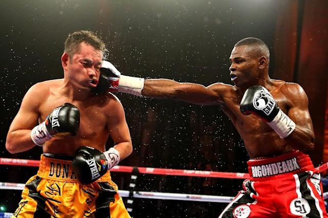 Guillermo Rigondeaux, right, is currently the undefeated WBO and World Boxing Association super bantamweight champion with a 15-0 record (AFP Photo/Al Bello)