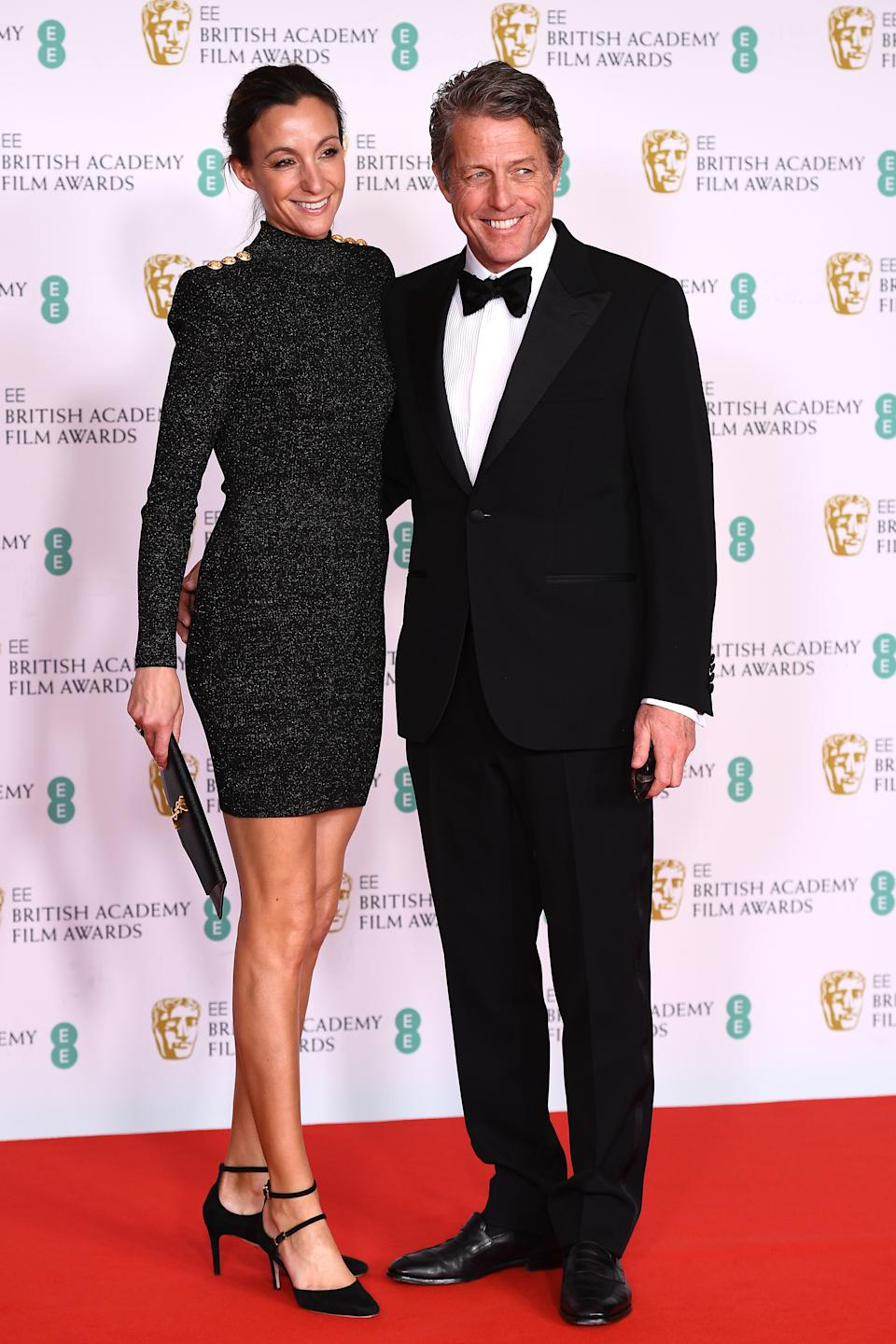 LONDON, ENGLAND - APRIL 11: Awards Presenter Hugh Grant and wife Anna Elisabet Eberstein attends the EE British Academy Film Awards 2021 at the Royal Albert Hall on April 11, 2021 in London, England. (Photo by Jeff Spicer/Getty Images)