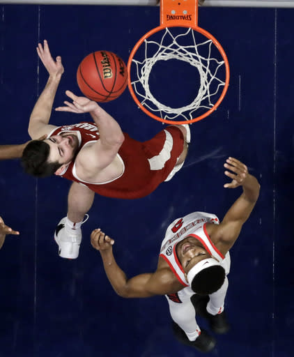 Alabama guard Riley Norris, left, tips in a shot over Mississippi guard Devontae Shuler (2) in the second half of an NCAA college basketball game at the Southeastern Conference tournament Thursday, March 14, 2019, in Nashville, Tenn. Alabama won 62-57. (AP Photo/Mark Humphrey)