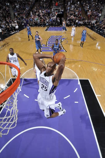 SACRAMENTO, CA - MARCH 18: Travis Outlaw #25 of the Sacramento Kings dunks the ball against the Minnesota Timberwolves on March 18, 2012 at Power Balance Pavilion in Sacramento, California. (Photo by Rocky Widner/NBAE via Getty Images)