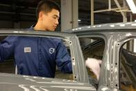 Worker is seen on a production line for Polestar, Volvo and Lynk&Co vehicles at a Geely plant in Taizhou