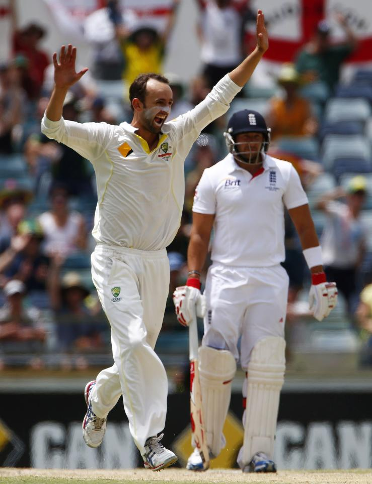 Australia's Nathan Lyon (L) celebrates after taking the wicket of England's Ben Stokes during the fifth and final day of the third Ashes test cricket match at the WACA ground in Perth December 17, 2013. REUTERS/David Gray(AUSTRALIA - Tags: SPORT CRICKET)