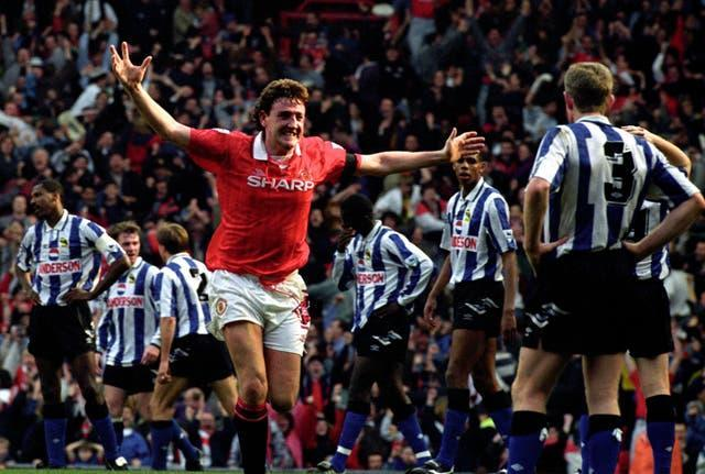 Steve Bruce celebrates scoring for Manchester United against Sheffield Wednesday
