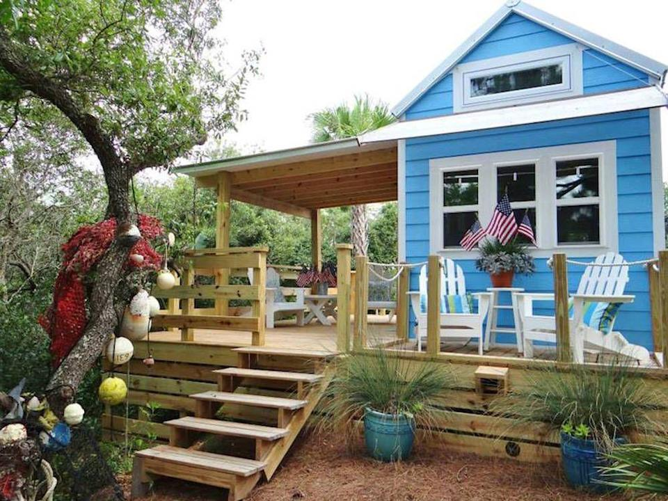 """<p>This tiny beach cottage on Florida's St. George Island is called """"Our Little Secret"""" by its owners. Small in size, it's mighty in design: Its coastal-cracker exterior is made of a Structured Insulated Paneling System built to withstand hurricane-force winds, while its <a href=""""http://tinyhouseswoon.com/st-george-island-tiny-house/#more-7927"""" rel=""""nofollow noopener"""" target=""""_blank"""" data-ylk=""""slk:cheery interior"""" class=""""link rapid-noclick-resp"""">cheery interior</a> features beadboard walls and ceilings and bamboo floors. Including the loft space, the 325-square-foot cottage sleeps two to four people, while a generous deck expands the living space into the outdoors for a perfect vacation retreat.</p><p><a class=""""link rapid-noclick-resp"""" href=""""https://www.facebook.com/ourlittlesecretbythesea"""" rel=""""nofollow noopener"""" target=""""_blank"""" data-ylk=""""slk:SEE INSIDE"""">SEE INSIDE</a></p>"""