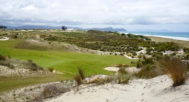 """<div class=""""caption""""> A look at the punchbowl third green from the fourth tee </div>"""