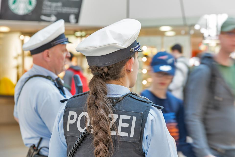 BERLIN, GERMANY - APRIL 20, 2019: Police patrol in Tegel airport. Police on high terror alert warned to be hyper vigilant. Berlin is the capital and largest city of Germany by both area and population