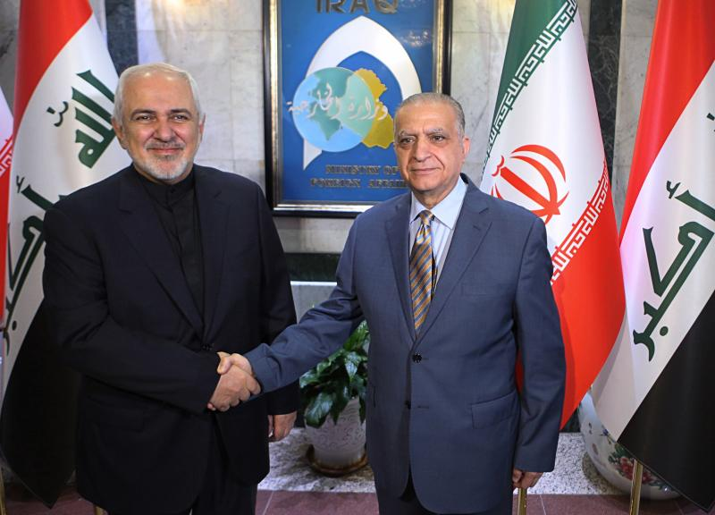 Iraqi Foreign Minister Mohamed Alhakim, right, shakes hands with his visiting Iranian counterpart Mohammad Javad Zarif at the Ministry of Foreign Affairs Building in Baghdad, Iraq, Sunday, May 26, 2019. (AP Photo/Khalid Mohammed)