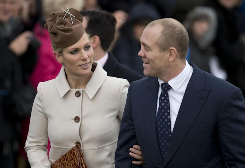 FILE - Zara Phillips and her husband rugby player Mike Tindall in this file photo dated Tuesday, Dec. 25, 2012, as they arrive for a traditional Christmas Day church service in Sandringham, England. Buckingham Palace announced Friday Jan, 17, 2014, that Queen Elizabeth II's granddaughter Zara Phillips and Mike Tindall have given birth to a 7 pounds, 12 ounces (3.5 kilograms) baby girl at Gloucestershire Royal Hospital. (AP Photo/Matt Dunham, FILE)