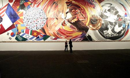 """FILE PHOTO - People view US artist James Rosenquist's """"Celebrating the Fiftieth Anniversary of the Signing of the Universal Declaration of Human Rights by Eleanor Roosevelt"""" at the Art 37 in Basel"""