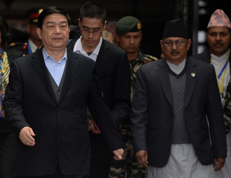 China's Defence Minister Chang Wanquan (L) is escorted by Nepalese officials after his arrival at Tribhuwan International Airport in Kathmandu on March 23, 2017