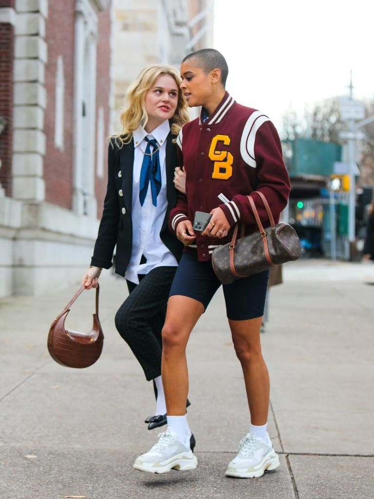 """<p>Aside from the new iterations of the uniforms, you'll also notice that the accessories like <a href=""""https://www.popsugar.com/fashion/jw-pei-bag-on-gossip-girl-reboot-48422477"""" class=""""link rapid-noclick-resp"""" rel=""""nofollow noopener"""" target=""""_blank"""" data-ylk=""""slk:handbags play a significant role in the characters' wardrobes"""">handbags play a significant role in the characters' wardrobes</a>, just like on the original series. """"With the bags, I chose a lot of secondhand, thrift, and resale pieces since there's a movement towards sustainability. Sustainability is a huge part of how Gen Z is shopping and giving these luxury bags a second life. This generation identifies with these heritage brands differently because of this and the fact that the quality of these bags has a much longer shelf life than disposable fashion."""" </p> <p>Of course, that didn't stop the reboot from including bags right off the runway, as you can tell from the first episode. """"It was important to have still the giant LV bag moment,"""" Eric revealed. """"I think it's sensational, fun, and part of the <b>GG</b> fantasy. But Serena [from the original series] was definitely not carrying a secondhand bag.""""</p>"""