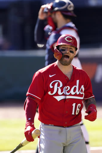 Cincinnati Reds' Tucker Barnhart (16) reacts to striking out against the Atlanta Braves in 12th inning during Game 1 of a National League wild-card baseball series, Wednesday, Sept. 30, 2020, in Atlanta. (AP Photo/John Bazemore)