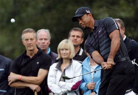 Woods of the U.S. plays a shot on the fifth hole during the first round of the inaugural Turkish Airlines Open in Antalya
