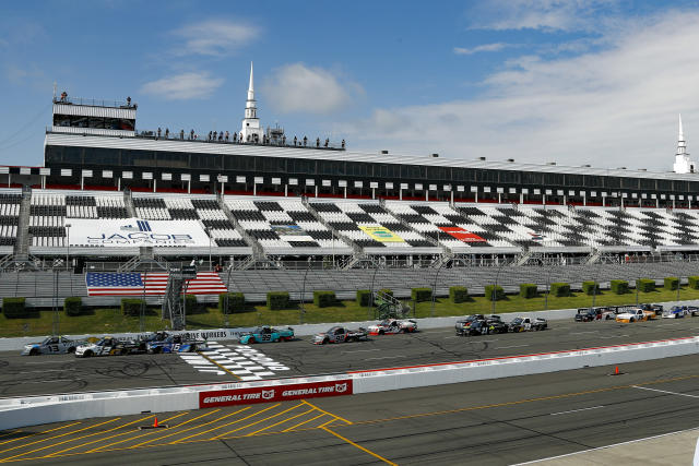 Johnny Sauter, in the 13 truck, leads the pack across the start line for the beginning of the NASCAR Truck Series auto race at Pocono Raceway, Sunday, June 28, 2020, in Long Pond, Pa. (AP Photo/Matt Slocum)