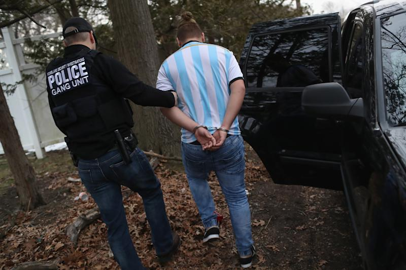 Homeland Security Investigations (HSI) ICE agents detain a suspected MS-13 gang member and Honduran immigrant at his home on March 29, 2018, in Brentwood, N.Y. (Photo: John Moore/Getty Images)
