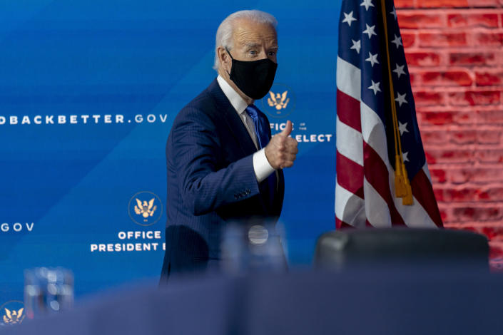 President-elect Joe Biden departs a news conference after introducing his nominees and appointees to economic policy posts at The Queen theater, Tuesday, Dec. 1, 2020, in Wilmington, Del. (AP Photo/Andrew Harnik)
