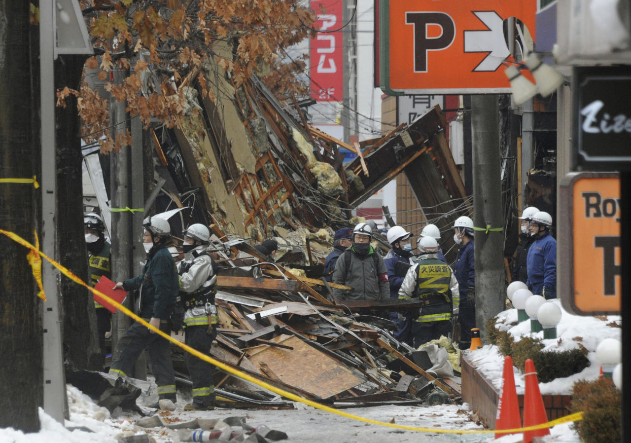 <p>Firefighters and police work at the scene of an explosion in Sapporo, Japan, Dec. 17, 2018. Dozens of people were injured in the explosion Sunday night at a Japanese restaurant in northern Japan, police said. The explosion occurred in Sapporo, the capital city of Japan's northern main island of Hokkaido, and caused nearby apartment buildings and houses to shake. (Photo: Kyodo News via AP) </p>