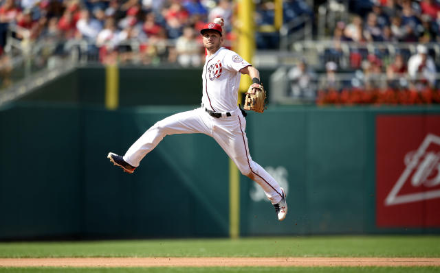 Washington Nationals shortstop Trea Turner leaps up to throw to first to get out Philadelphia Phillies Freddy Galvis during the seventh inning of a baseball game, Sunday, Sept. 10, 2017, in Washington. The Nationals won 3-2. (AP Photo/Nick Wass)