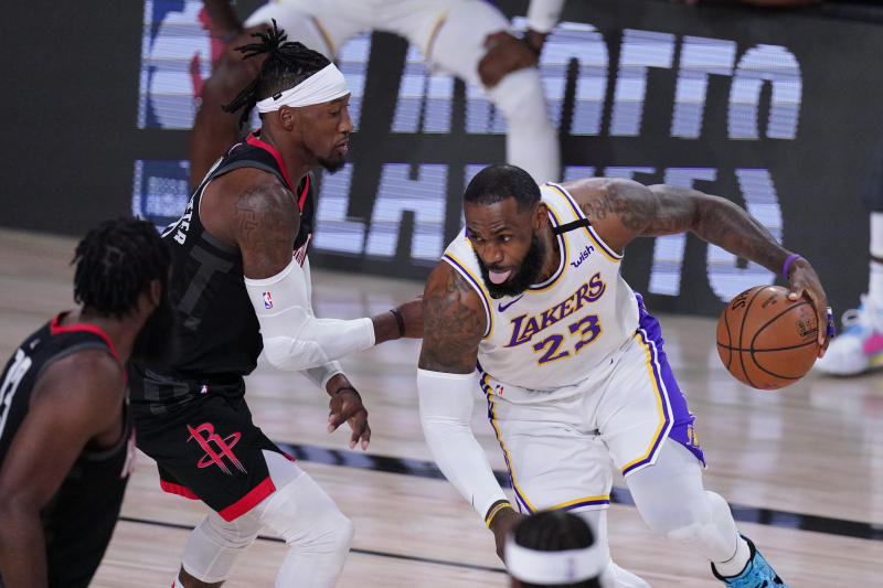 Los Angeles Lakers' LeBron James (23) drives to the basket against the Houston Rockets during the first half of an NBA conference semifinal playoff basketball game Saturday, Sept. 12, 2020, in Lake Buena Vista, Fla. (AP Photo/Mark J. Terrill)