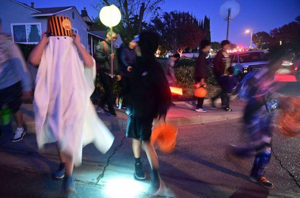 PHOTO: Children go trick or treating on Halloween night in Monterey Park, Calif., Oct. 31, 2019. (Frederic J. Brown/AFP via Getty Images, FILE)