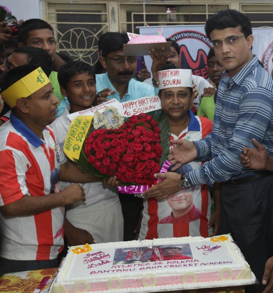 Kolkata: Former Indian cricketer Sourav Ganguly cuts a cake during a programme organised by his supporters to celebrated his 43rd birthday in Kolkata on July 8, 2015. (Photo: IANS)