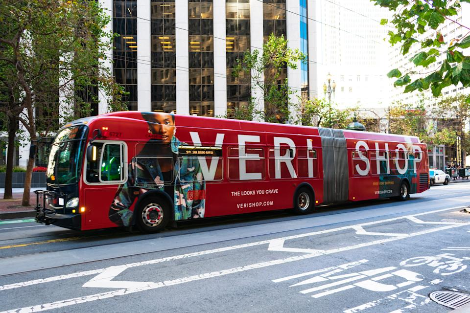 San Francisco, California, USA - Circa, 2019 : Retail online-shopping website Verishop advertisement on MUNI bus on city street. Verishop is a new e-commerce site that sells a curated selection of women's and men's fashion, home goods, and beauty products.
