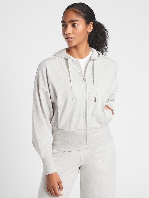 <p>If you're in the market for a traditional zip-up, this light gray <span>Athleta Balance Sweatshirt</span> ($98) is a cute fitted and cropped pick.</p>