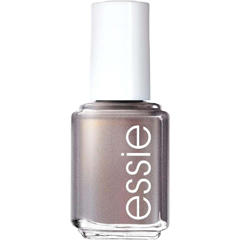 """<p>Metallic pewter nails will allow you to connect to the deepest parts of yourself that you want to honor and glow. Once you adorn your nails with this iridescent hue, you'll find that you are evolving into the best version of yourself and allowing yourself to keep an open mind.</p> <p><strong>To shop: </strong>$8; <a href=""""https://www.amazon.com/essie-Polish-Glossy-Finish-Social-Lights/dp/B074N3L252?&linkCode=ll1&tag=issignshouldbewearingnailpolishcolortaurusseasonlstardust0421-20&linkId=38854c7fbb120954390f998a5758b686&language=en_US&ref_=as_li_ss_tl"""" rel=""""nofollow noopener"""" target=""""_blank"""" data-ylk=""""slk:amazon.com"""" class=""""link rapid-noclick-resp"""">amazon.com</a></p>"""